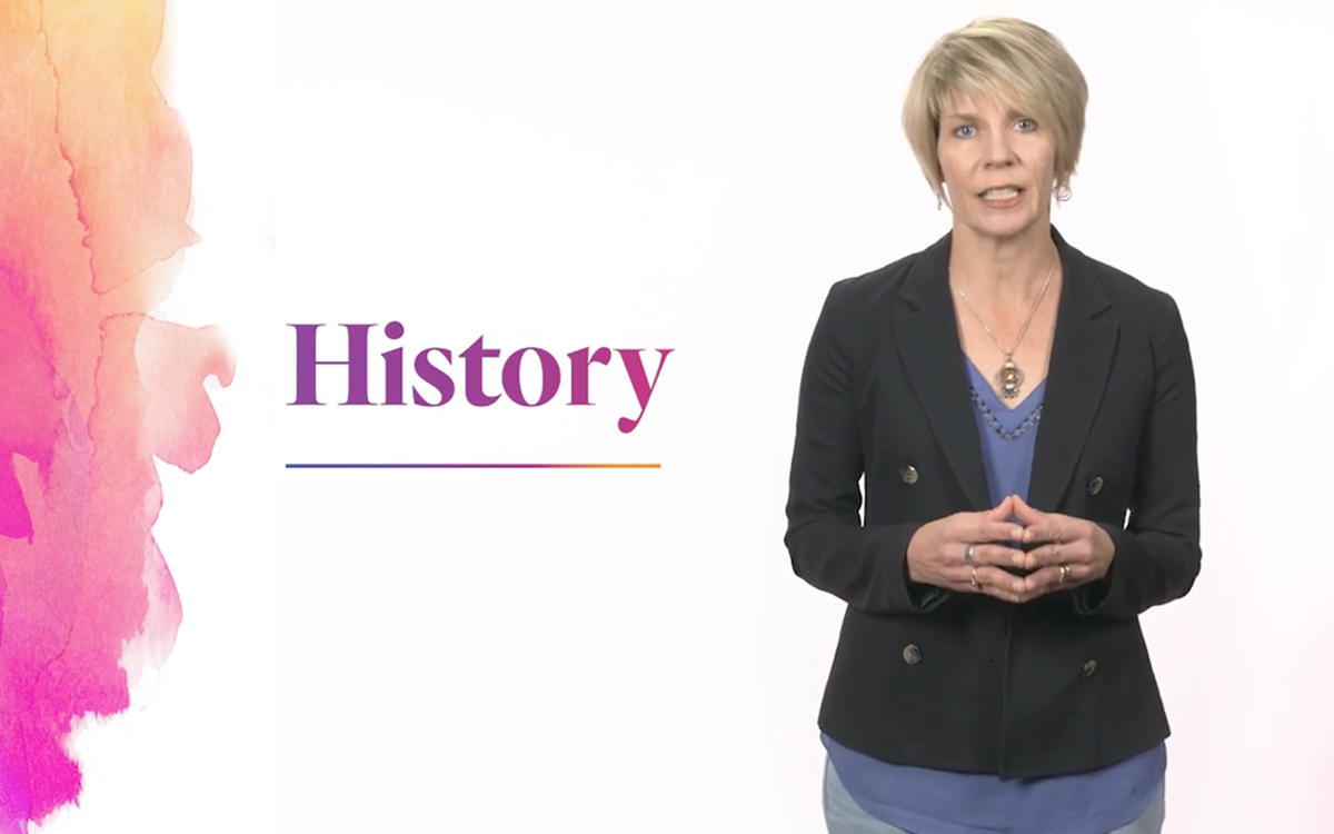 Caucasian woman speaking in front of a white background with purple text